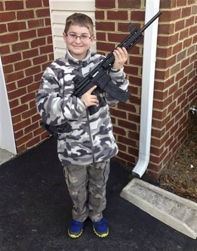 boy-in-camo-with-gun