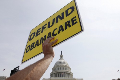 A man holds a sign at the Tea Party Patriots 'Exempt America from Obamacare' rally on the west lawn of the U.S. Capitol in Washington