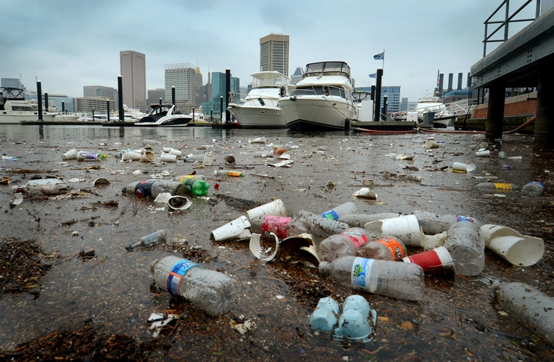 07.20.12- BALTIMORE, MD- A mass of litter and debris float on the surface of the water on the south side of the Inner harbor near the Rusty Scupper Restaurant. The flooding from yesterdays rainstorm played its part to sweep some of the garbage that missed the trash cans around Baltimore  into the waters that feed the Chesapeake Bay. (Maximilian Franz/The Daily Record).